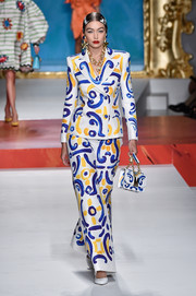 Gigi Hadid looked whimsical-chic in a painterly-print pantsuit at the Moschino Spring 2020 show.