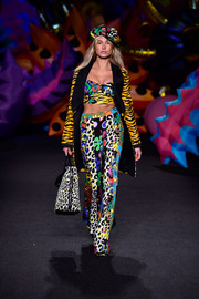 Hailey Baldwin looked like she just stepped out of a cartoon in these multicolored mixed-print pants (and matching top) while walking the Moschino runway.