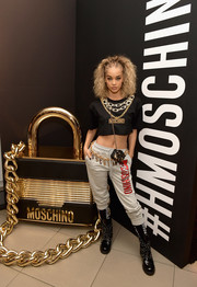 Jasmine Sanders donned a chain-embroidered crop-top by Moschino x H&M for the brand's Los Angeles launch event.