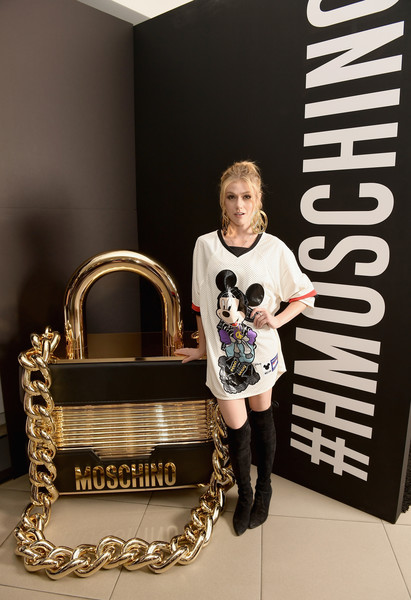 Katherine McNamara looked cute in an oversized Mickey Mouse tee by Moschino x H&M during the brand's Los Angeles launch event.
