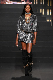 Naomi Campbell lit up the runway with this silver sequined mini dress at the Moschino x H&M fashion show.