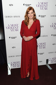 Jessica Chastain kept it timeless in a long-sleeve red wrap dress by Giorgio Armani at the New York premiere of 'A Most Violent Year.'