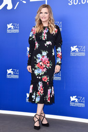 Michelle Pfeiffer went ultra ladylike in a Dolce & Gabbana floral dress with a pleated hem at the Venice Film Festival photocall for 'Mother!'