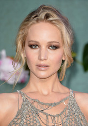 Jennifer Lawrence paired a messy updo with a mesh gown for total sex appeal at the UK premiere of 'Mother!'