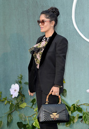 Salma Hayek accessorized with a chic Gucci Queen Margaret tote at the UK premiere of 'Mother!'