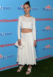 Jordana Brewster added girly appeal to her sporty look via a pair of white strappy sandals.