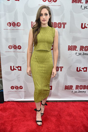 Carly Chaikin capped off her look with strappy black heels.