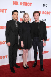 Lucy Boynton kept it cute in a black baby doll dress with a ruffle neckline and cuffs at the premiere of 'Mr. Robot' season 4.