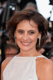 Ines de la Fressange accessorized with a stunning pair of dangling diamond earrings by Chopard.