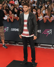 Josh Bowman rocked the rebel look with a classic leather jacket.
