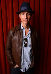 Matthew McConaughey opted for a classic brown leather jacket for his red carpet look at 'Mud' at SXSW 2013.