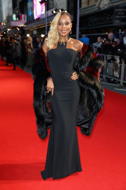 Mary J. Blige polished off her ultra-sophisticated look with a black and red fur coat by Dennis Basso.