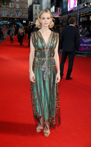 Carey Mulligan was all about whimsical glamour in a sheer Gucci Grecian gown with gold and silver sequin embellishments and a bright green underlay at the European premiere of 'Mudbound.'