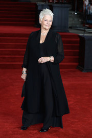 Judi Dench layered a black coat over a matching gown for the world premiere of 'Murder on the Orient Express.'