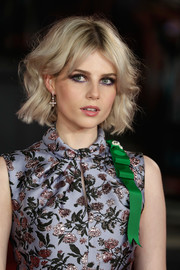 Lucy Boynton wore a pair of dangling diamond earrings to the world premiere of 'Murder on the Orient Express.'