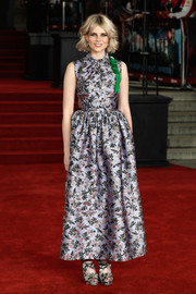 Lucy Boynton completed her busy-looking ensemble with a pair of floral platform sandals.