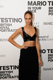 Joan Smalls made quite the statement in a barely-there leathery bra-top—and wow did she look stunning!