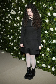 Lorde punctuated her black look with sheer white tights.