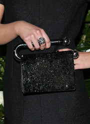 Imogen Poots' statement ring coordinated perfectly with her bag.