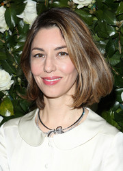Sofia Coppola styled her look with a cute layered diamond necklace.