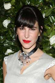 Caroline Sieber looked youthful with her ponytail and bangs at the MoMA Film Benefit.