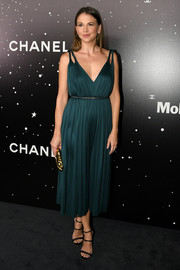 Sutton Foster looked effortlessly stylish in a dark emerald cocktail dress at the MoMA Tribute to Martin Scorsese.