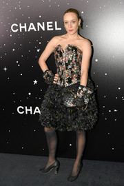 Chloe Sevigny looked flamboyant in a strapless, heavily embellished Chanel Couture dress at the MoMA Tribute to Martin Scorsese.