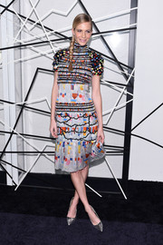 Poppy Delevingne brought a playful mix of colors to the Alfonso Cuaron benefit with this Chanel print dress.
