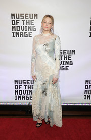 Haley Bennett finished off her red carpet attire with black crisscross-strap heels by Jimmy Choo.