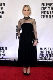 Sarah Paulson matched her LBD with a Thale Blanc box clutch featuring pearlized edges and dots.