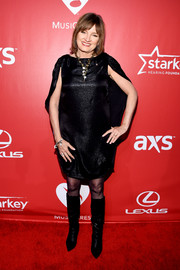 Christine Albert rocked a caped LBD with knee-high boots at the MusiCares Person of the Year Gala.