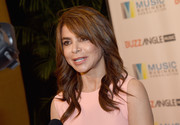 Paula Abdul wore her hair in feathery waves with side-swept bangs at the Music Biz 2017.