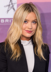 Laid-back waves balanced out Laura Whitmore's structured pantsuit at the Music Industry Trust Awards.