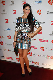 Sila Sahin looked ultra-mod in her sequined geometric-print dress.