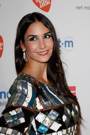 Sila Sahin topped off her look at the Music Meets Media party with a sleek center-parted 'do.
