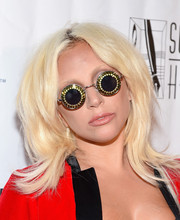 Lady Gaga spiced up her look with a pair of bedazzled round sunglasses.