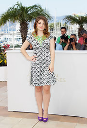 Eve Hewson upped the wow factor of her graphic print dress with purple suede peep-toes.