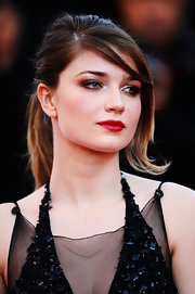 Eve Hewson paired her flawless skin with matte red lipstick.