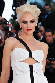 Gwen Stefani opted for a dramatic look at the Cannes Film Festival. She wasn't afraid to e daring with a saturated application of smokey shadow and a bright crimson lip.