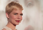 Michelle Williams wore a cranberry-colored lipstick with a sheer gold metallic finish at the Japanese premiere of 'My Week With Marilyn.'