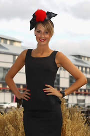 Laura Dundovic complemented her classic LBD with a fun red and black pompom fascinator at the Myer 2012 Autumn/Winter Racing launch.