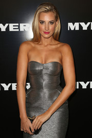 Laura was a vision in silver - posing in a sexy strapless dress at the Myer launch event.