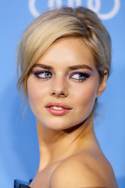 Samara Weaving chose a chic pinned updo to pull back her summery blonde tresses.