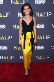 Isabela Moner got glam in a bow-adorned black and yellow slip dress for the NALIP 2018 Latino Media Awards.