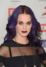 Katy Perry gave off a goth vibe at the NARM Music Biz Awards, wearing an edgy black dress and sweeping on a deep burgundy lipstick.