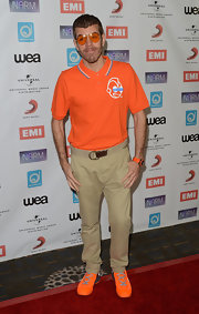 It felt strange to see Perez Hilton wearing regular khakis and a polo shirt. But then we saw the neon orange sneakers and thought, 'Yup, it's him alright.'
