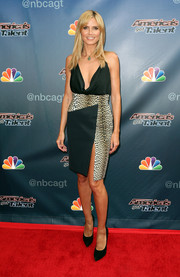 Heidi Klum was smoking-hot at the 'America's Got Talent' red carpet event in a leopard print-panel dress with a plunging neckline and a thigh-high slit.