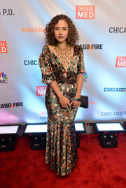 Dora Madison worked a vintage vibe in a printed mermaid gown paired with a statement necklace at the premiere of NBC's 'Chicago Fire,' Chicago P.D.,' and 'Chicago Med.'