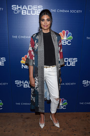 Underneath her coat, Rachel Roy was edgy in ripped white jeans.