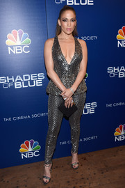 Jennifer Lopez went all out with the shimmer in a plunging silver peplum jumpsuit by Zuhair Murad at the premiere of 'Shades of Blue' season 2.